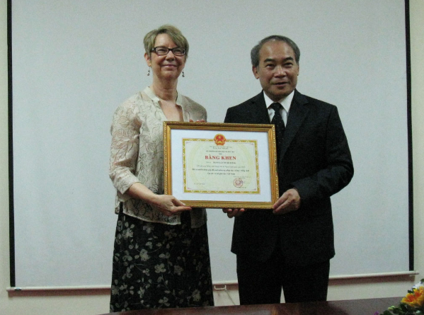 Diana was awarded a Bang khen from MOET in 2013. Shown with Vice Minister of Education Mr. Hien.